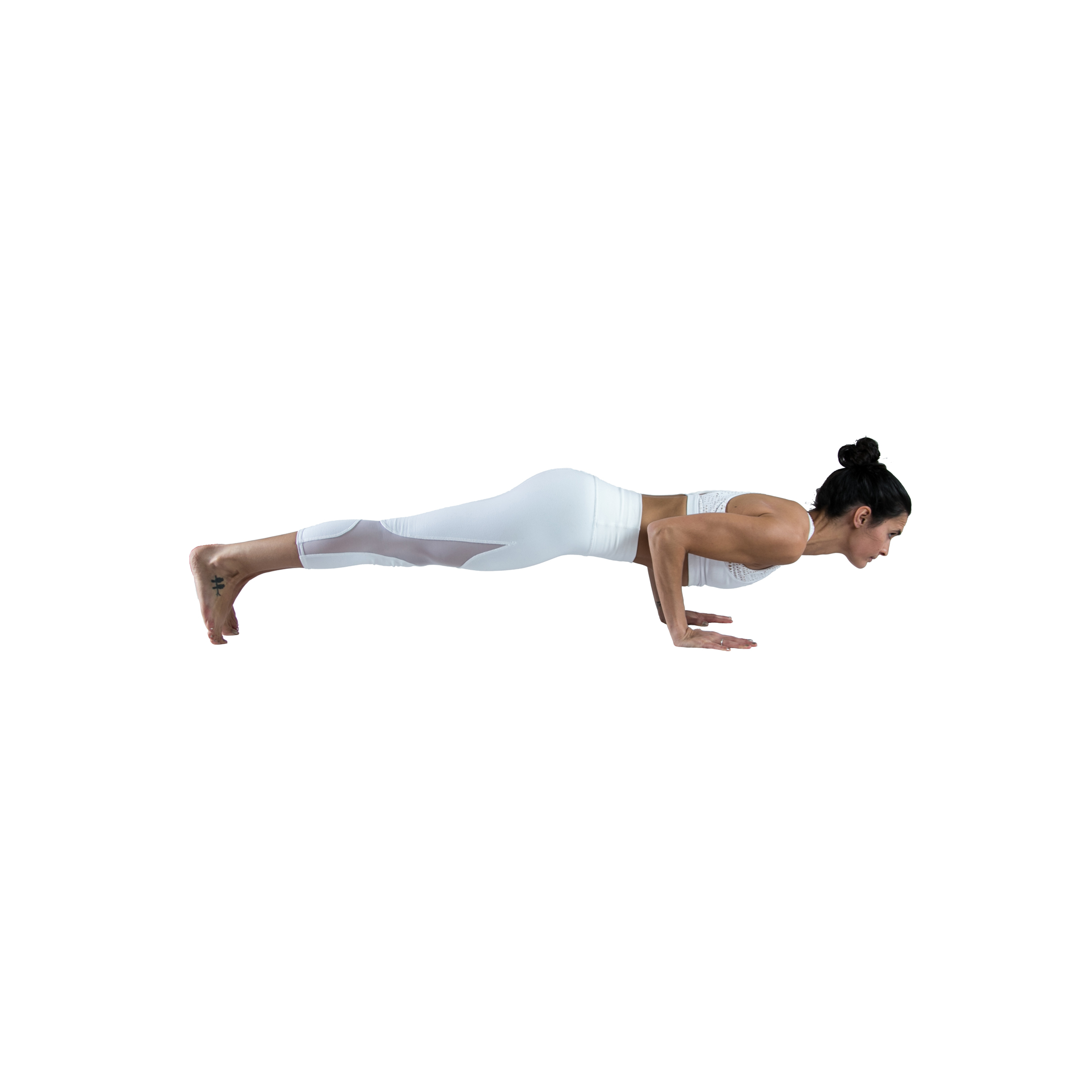 woman practices low plank pose