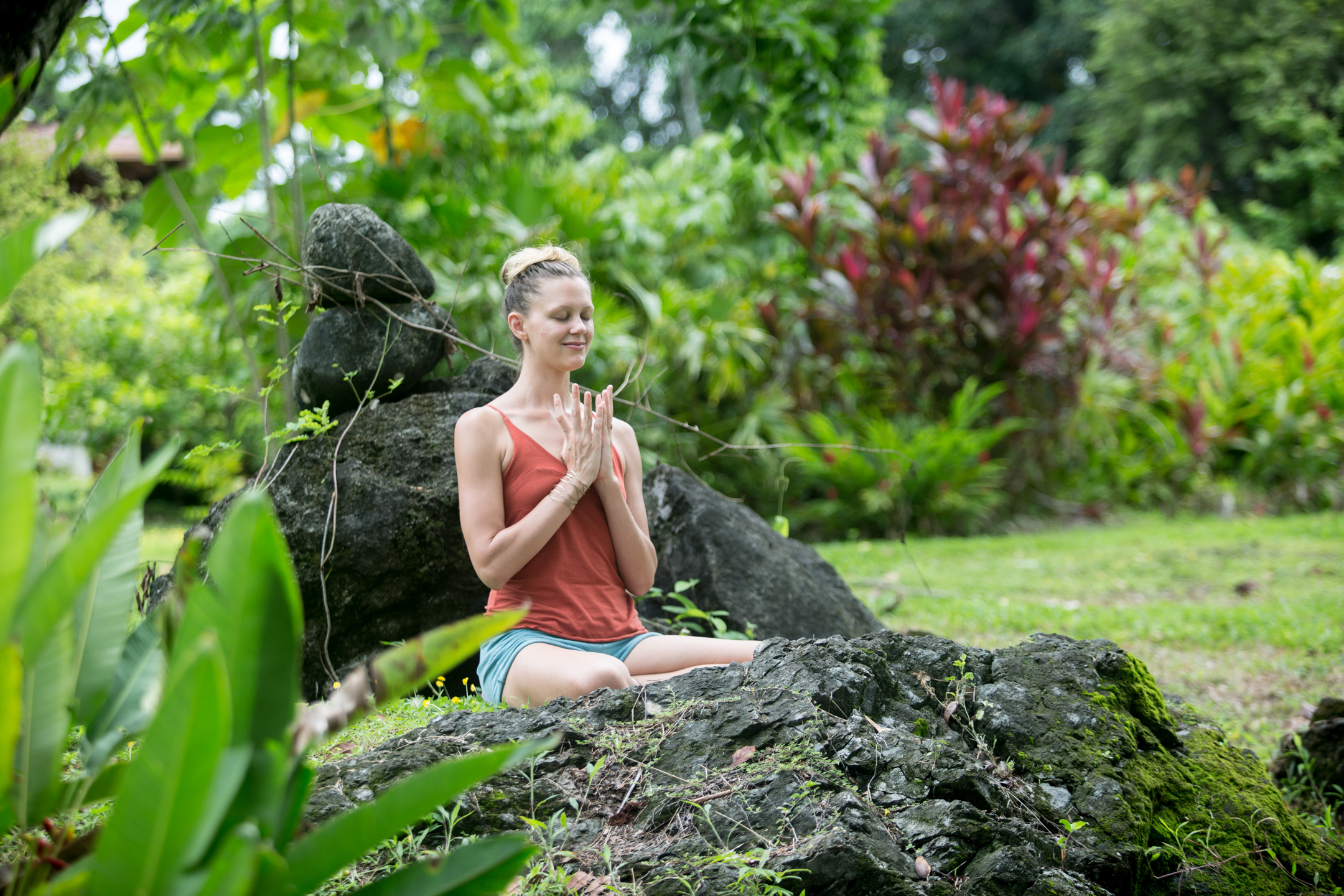 woman meditates in jungle setting