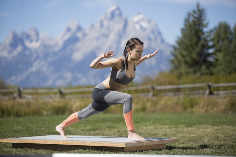 woman practices a powerful lunge - yogatoday