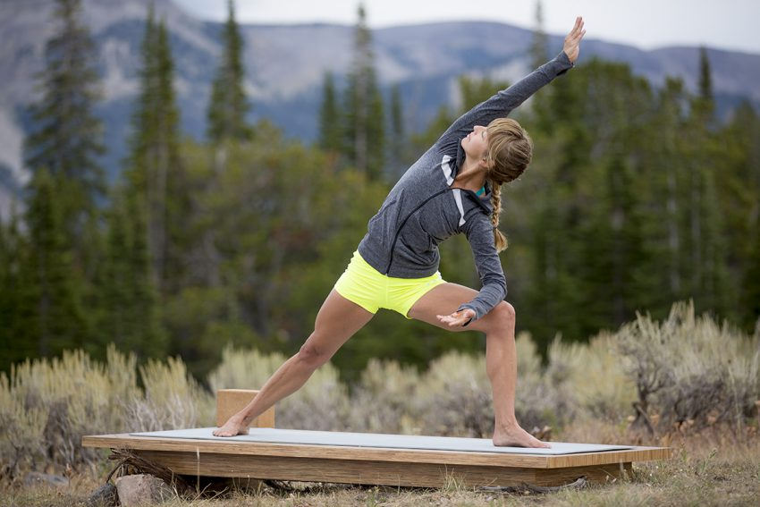 woman practices yoga outdoors- yogatoday