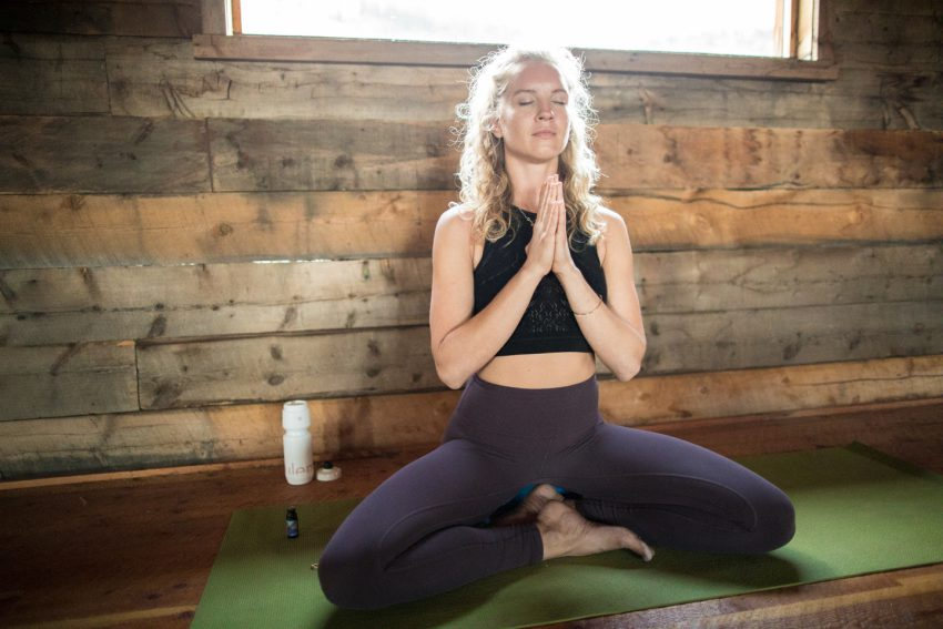 woman practices morning meditation - YogaToday