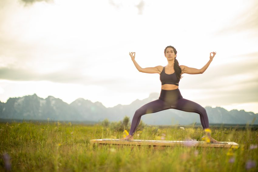 woman practices yoga in Grand Teton National Park