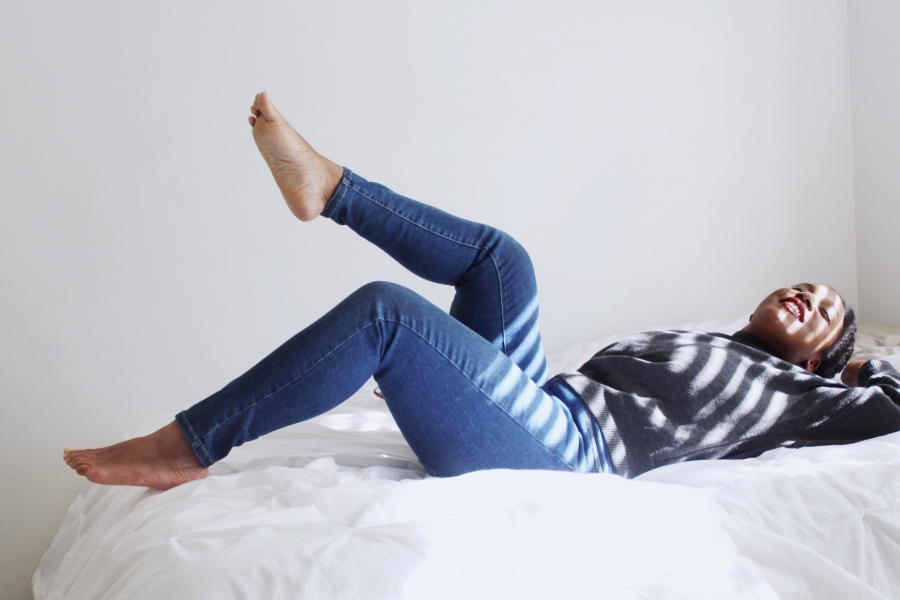 woman relaxes on a bed