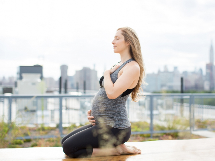 pregnant woman practices yoga
