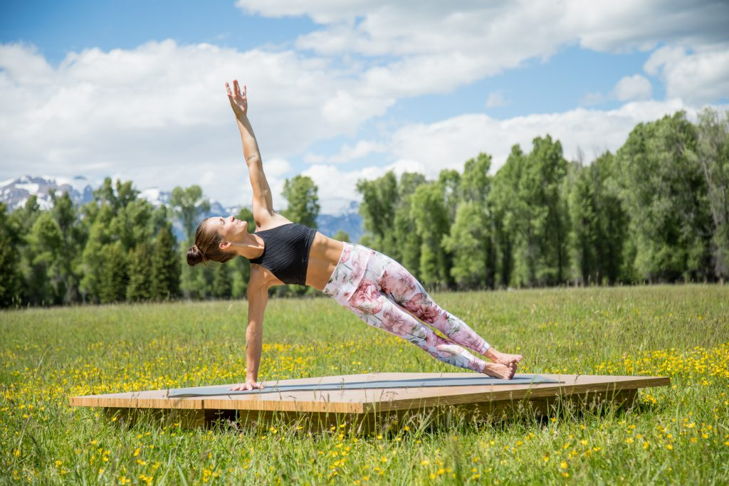 Pilates instructor practices side plank pose for core strength and healthy weight loss -yogatoday