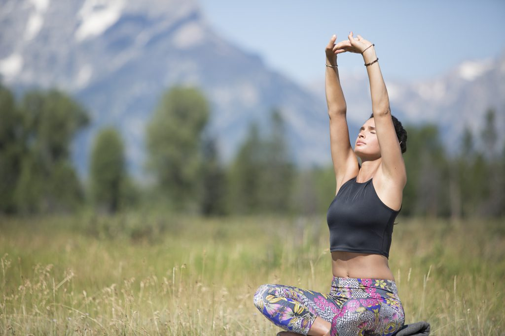 woman practices yoga in Jackson Hole, Wyoming -yogatoday