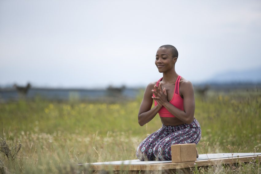 Woman Meditates Outdoors in Grand Teton National Park